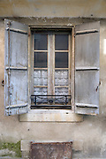 window with old style shutters