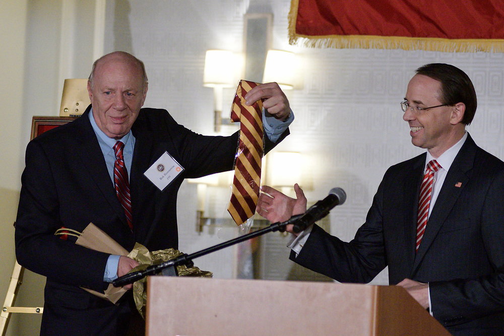 Dep. Attorney General Rod Rosenstein receives an crimson-yellow tie out of the hands of his father and Central High alumni Rob Rosensten, during the annual alumni dinner of Central High, on Tuesday evening. (Bastiaan Slabbers for WHYY)