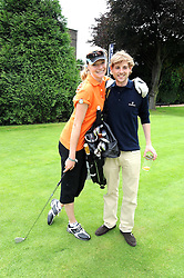 JODIE KIDD and THOMAS GEORGE at the Mini Masters Golf tournament in aid of LEUKA - London's first celebrity golf tournament held at Duke's Meadow Golf Club, Dan Mason Drive, London W4 on 14th July 2008.<br /> <br /> NON EXCLUSIVE - WORLD RIGHTS