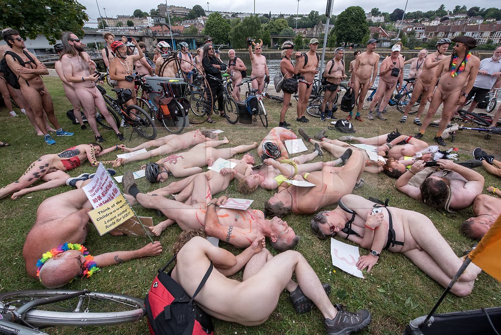"""© Licensed to London News Pictures.  <br /> 17/06/2018; Bristol, UK. Symbolic """"die-in"""" to commemorate the 23 cyclists that have been killed on Bristol's roads, at The World Naked Bike Ride through Bristol city centre. The event sees hundreds of naked and near naked cyclists cycle around Bristol city centre to campaign for improved cycle routes in Bristol and to raise awareness of the dangers and vulnerability cyclists in the city face on a daily basis. The event included a symbolic """"die-in"""" to commemorate the 23 cyclists that have been killed on Bristol's roads. Photo credit: Simon Chapman/LNP"""