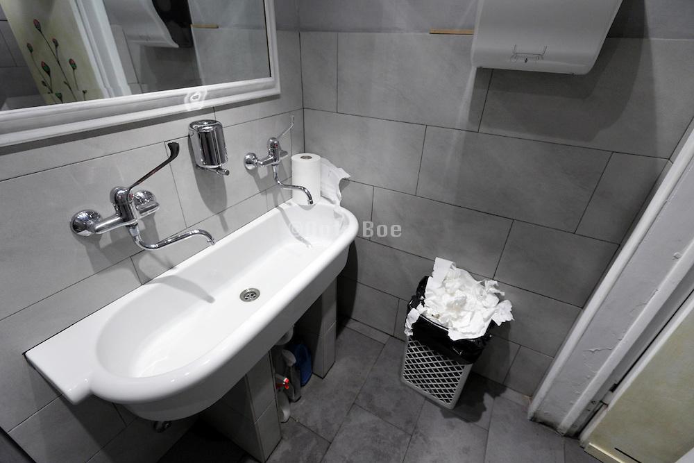 sink inside a bars public toilet