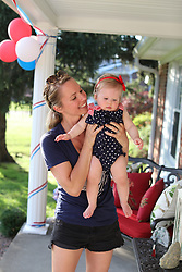Gemma Marie 10 months celebrates her first Fourth of July with Winston and the family and climbing steps, Wednesday, July 04, 2018  at Cedar Shake Shack in Louisville .