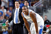 Marquis Teague #25 of the Kentucky Wildcats looks on against the Iowa State Cyclones during the third round of the NCAA men's basketball championship on March 17, 2012 at KFC Yum! Center in Louisville, Kentucky. Kentucky advanced with an 87-71 win. (Photo by Joe Robbins)