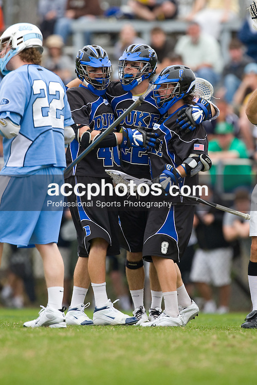 15 March 2008: Duke Blue Devils men's lacrosse attackman Matt Danowski (40), midfielder Ned Crotty (22), attackman Max Quinzani (8) in a 19-9 win over the North Carolina Tar Heels at Koskinen Stadium in Durham, NC.