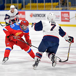 WHITBY, - Dec 17, 2015 -  Game #10 - United States vs. Russia at the 2015 World Junior A Challenge at the Iroquois Park Recreation Complex, ON. Mikhail Meshcheryakov #25 of Team Russia attempts to get the puck past Keegan Ford #7 of Team United States during the first period.<br /> (Photo: Shawn Muir / OJHL Images)