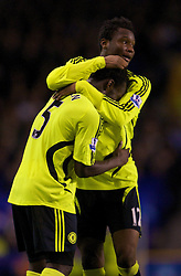 LIVERPOOL, ENGLAND - Thursday, April 17, 2008: Chelsea's Michael Essien celebrates scoring the opening goal against Everton, with team-mate John Mikel Obi during the Premiership match at Goodison Park. (Photo by David Rawcliffe/Propaganda)