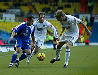 Photo: Andrew Unwin.<br />Leeds United v Cardiff City. Coca Cola Championship.<br />10/12/2005.<br />Cardiff's Kevin Cooper (L) looks to go past Leeds' Dan Harding (R).