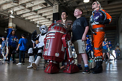 May 4, 2018 - Kansas City, MO, U.S. - KANSAS Kansas City, MO - MAY 04:  Fans take pictures next to cosplayers on Star Wars night at the K shortly before the MLB game between the Detroit Tigers and the Kansas City Royals on Friday May 4, 2018 at Kauffman Stadium in Kansas City, MO.  (Photo by Nick Tre. Smith/Icon Sportswire) (Credit Image: © Nick Tre. Smith/Icon SMI via ZUMA Press)