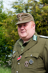 Reenactor dressed as an officer from the 21st Panzer division Afrika Korps at the Northallerton Wartime Weekend he is wearing the Iron Cross Second Class Medal Ribbon, Infantry Assault Badge and Iron Cross First class<br />