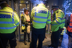 © Licensed to London News Pictures. 08/10/2019. London, UK. An Extinction Rebellion activists being arrested after glueing themselves to the Home Office in Westminster. Activists have converged on Westminster for a second day, blockading roads in the area and calling on government departments to 'Tell the Truth' about what they are doing to tackle the Emergency. Photo credit: Ben Cawthra/LNP