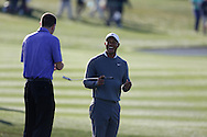 Tiger Woods laughing and happy with Mark Steinberg manager and sports agent<br /> WM Phoenix Open 2015, TPC Scottsdale, Arizona, USA<br /> January 2015<br /> Picture Credit:  Mark Newcombe / www.visionsingolf.com