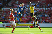 Nottingham Forest goalkeeper Dorus de Vries (1) collides with Burton Albion midfielder Lucas Akins (10) resulting in a serious injury during the EFL Sky Bet Championship match between Nottingham Forest and Burton Albion at the City Ground, Nottingham, England on 6 August 2016. Photo by Jon Hobley.