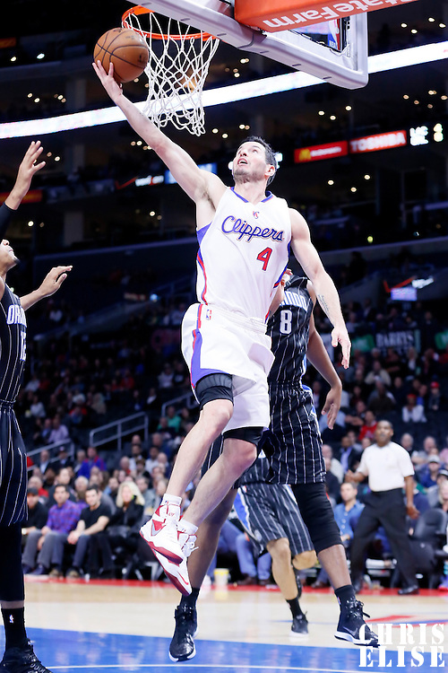 03 December 2014: Los Angeles Clippers guard J.J. Redick (4) goes for the reverse layup past Orlando Magic forward Channing Frye (8) during the Los Angeles Clippers 114-86 victory over the Orlando Magic, at the Staples Center, Los Angeles, California, USA.