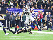 Jan 20, 2019; New Orleans, LA, USA; Los Angeles Rams tight end Tyler Higbee (89) hurdles over New Orleans Saints cornerback P.J. Williams (26) during the NFC Championship at Mercedes-Benz Superdome. The Rams beat the Saints in overtime 26-23 and head to Super Bowl 53 in Atlanta. (Steve Jacobson/Image of Sport)