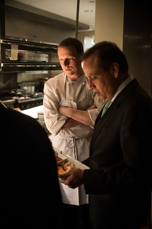 Photo by Matt Roth<br /> Assignment ID: 30142124A<br /> <br /> Restauranteur Ashok Bajaj talks with chef Gregory McCarty during a brief stop to his newest restaurant, Nopa, during his nightly rounds in Washington, D.C. on Thursday, May 09, 2013.