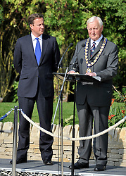 © licensed to London News Pictures. CARTERTON, UK.  01/09/11.David Cameron watches a speech by Councillor Patrick Greene, the Chairman of Oxfordshire City Council. A ceremony, attended by British Prime Minister David Cameron,  takes place at The Memorial Garden at Norton Way in Carterton, Oxfordshire today (01 Sept 2011). The Garden will become the focal point during the repatriation of UK service personnel from RAF Brize Norton. The Union Flag that used to fly at repatriations in Wooton Bassett was handed over and was blessed. . Mandatory Credit Stephen Simpson/LNP