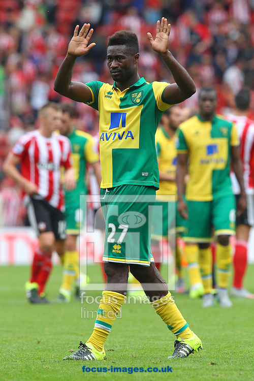 Alexander Tettey of Norwich apologises to the traveling Norwich fans at the end of the Barclays Premier League match at the St Mary's Stadium, Southampton<br /> Picture by Paul Chesterton/Focus Images Ltd +44 7904 640267<br /> 30/08/2015