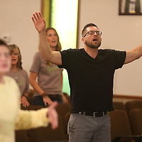 Adam Robison | BUY AT PHOTOS.DJOURNAL.COM<br /> Pastor Kyle Felke, from Valparaiso Indiana, worships during a Revive Tupelo worship service held during lunch at the Temple of Compassion and Deliverance church in Tupelo Monday.