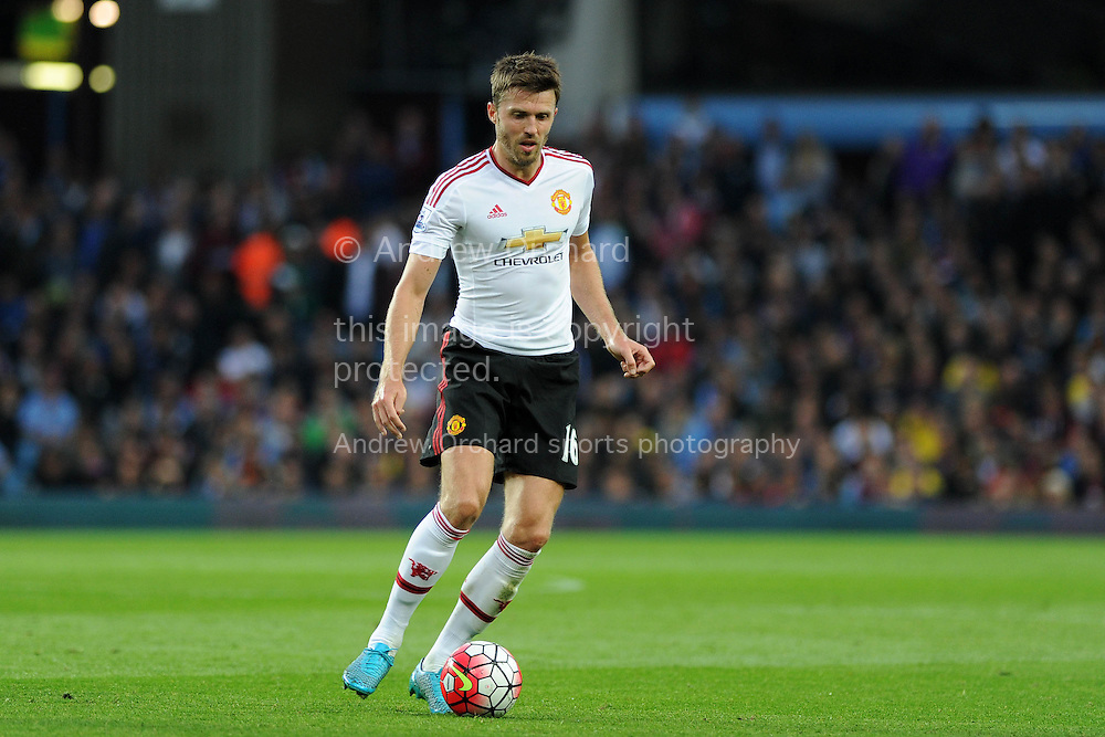 Michael Carrick of Manchester Utd in action.Barclays Premier League match, Aston Villa v Manchester Utd at Villa Park in Birmingham, Midlands on Friday 14th August  2015.<br /> pic by Andrew Orchard, Andrew Orchard sports photography.