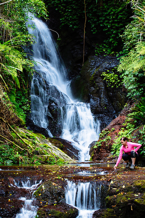 A hiker below Elebana Falls in Lamington National Park.