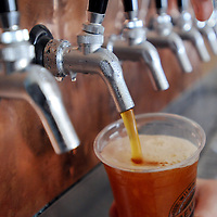 John Savard draws a beer from the tap for a customer at Wilmington Brewing Company.