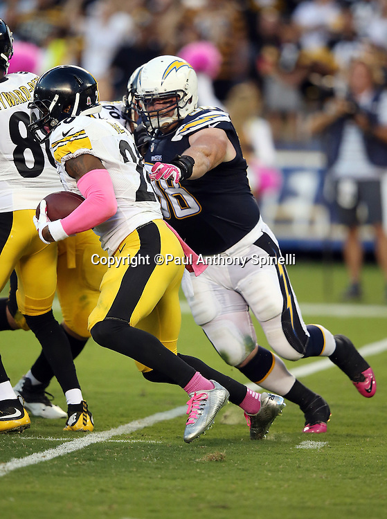 Pittsburgh Steelers running back Le'Veon Bell (26) is chased by San Diego Chargers nose tackle Sean Lissemore (98) as he runs the ball during the 2015 NFL week 5 regular season football game against the San Diego Chargers on Monday, Oct. 12, 2015 in San Diego. The Steelers won the game 24-20. (©Paul Anthony Spinelli)