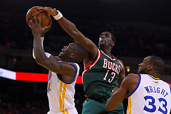 Mar 16, 2012; Oakland, CA, USA; Golden State Warriors point guard Nate Robinson (2) is fouled by Milwaukee Bucks forward Ekpe Udoh (13) during the fourth quarter at Oracle Arena. Milwaukee defeated Golden State 120-98. Mandatory Credit: Jason O. Watson-US PRESSWIRE