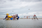 Two Black Hawk helicopters fly past a flooded playground in the Breezy Point neighborhood of the Rockaways. Three helicopter carrier ships were sent to the coast of New York and New Jersey to aid in the rescue and recovery after the superstorm Sandy.