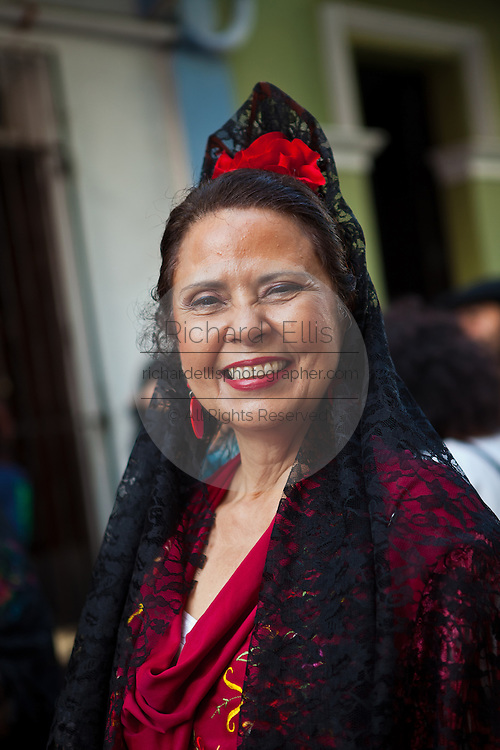 A woman dressed in traditional Puerto Rican costume at the Festival of San Sebastian in San Juan, Puerto Rico.