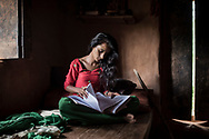 Surekha studies inside her house some months after she had her first period. In her neighbor village, the school is placed near a temple. There, scared of insulting the Gods, menstrual girls usually don't attend class. Hygiene conditions in most of the schools don't help with tackling this stigma, so girls just stay home, scared of getting publicly shamed.
