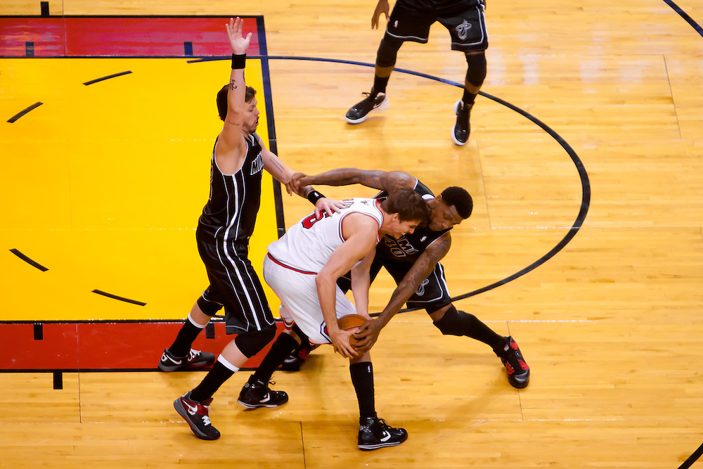 MIAMI, FL -- January 29, 2012 -- Miami's Udonis Haslem, right, and Mike Miller, left, battle Chicago's Kyle Korver during the Heat's 97-93 win over the Bulls at American Airlines Arena in Miami, Fla., on Sunday, January 29, 2012.  (Chip Litherland for ESPN the Magazine)