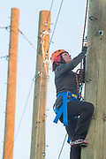 Woman climbing at the College of Southern Idaho Challenge Rope Course Twin Falls, Idaho.