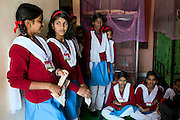 Ritu Gaur, 13, (second from left) is talking to her roommates inside their dorm in the Jamoniya Tank Girls Hostel, near Sehore, Madhya Pradesh, India, where the Unicef India Sport For Development Project has started in 2012. Covering 313 state-run girls' hostels and 207 mixed hostels in Madhya Pradesh, the project ensures that children from Scheduled Tribes (ST) and others amongst the poorest people in India, can easily access education and be introduced to sports. Field workers from Unicef also oversee their nutrition and monitor the overall conditions of each pupil.