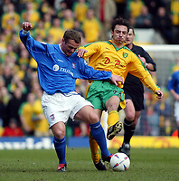 Photo:Scott Heavey<br />Norwich City V Ipswich Town. 02/03/03.<br />Jim Magilton (left) of Ipswich takes on Clint Easton of Norwich during this Nationwide division 1 match.
