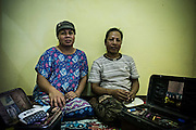 Mba Lam (L) and Mba Win (R) pose for photograph in their room in a lodge provided by Ludruk Karya Budaya owner for the transvestites player in Mojokerto, East Java, Indonesia, June 7, 2015. Both are friend since childhood. Mba Lam joined the group in 1986 and Mba Win joined one year after.  To support the daily needs, Mba Lam has a chicken farm with estiimated 100 chickens; and Mba Win sales clothes in credit.