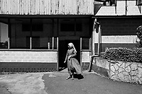 Scenes from a care center for leprosy victims and others suffering from grim afflictions run by the Sisters of Charity--a group of nuns who have given up most worldly comforts in order to care for the sick and less fortunate.