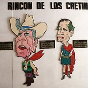 """Corner of the Cretins"" is a satire of former Cuban dictator Fulgencio Batista, left, former U.S. Presidents Ronald Reagan, George H. Bush and George W. Bush. Museum of the Revolution, Havana's most famous museum is located in the former presidential palace of the 1950's dictator Fulgencio Batista. Following the 1959 Revolution, it was converted into a museum celebrating the Cuban Revolution. Photography by Jose More"