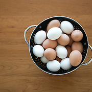 Brown and white eggs in a black colander.<br /> <br /> For all details about sizes, paper and pricing starting at $85, click &quot;Add to Cart&quot; below.