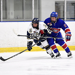 TORONTO, ON  - OCT 29,  2017: Ontario Junior Hockey League game between the Toronto Jr. Canadiens and the Toronto Patriots, Dante Spagnuolo #15 of the Toronto Patriots battles for position with Jeremy Smith #12 of the Toronto Jr. Canadiens during the first period.<br /> (Photo by Andy Corneau / OJHL Images)