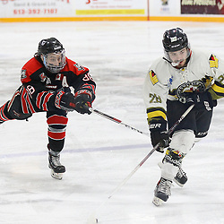 """TRENTON, ON  - MAY 5,  2017: Canadian Junior Hockey League, Central Canadian Jr. """"A"""" Championship. The Dudley Hewitt Cup Game 7 between Georgetown Raiders and the Powassan Voodoos.   Andrew Court #88 of the Georgetown Raiders tries to break up  Gabriel Rheault #28 of the Powassan Voodoos shot during the first period<br /> (Photo by Alex D'Addese / OJHL Images)"""