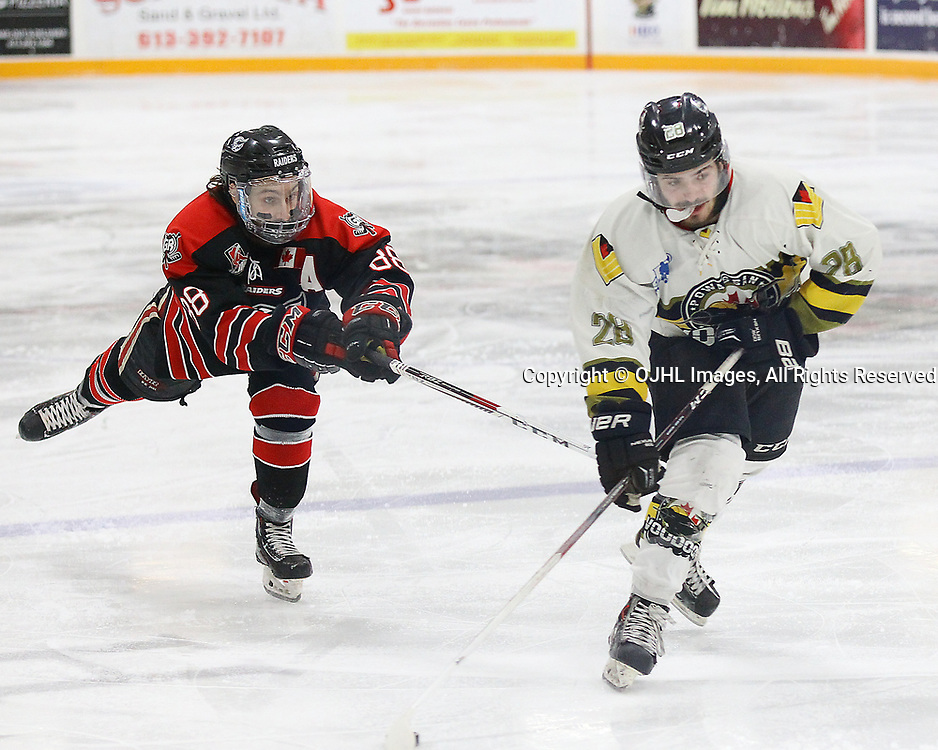 TRENTON, ON  - MAY 5,  2017: Canadian Junior Hockey League, Central Canadian Jr. &quot;A&quot; Championship. The Dudley Hewitt Cup Game 7 between Georgetown Raiders and the Powassan Voodoos.   Andrew Court #88 of the Georgetown Raiders tries to break up  Gabriel Rheault #28 of the Powassan Voodoos shot during the first period<br /> (Photo by Alex D'Addese / OJHL Images)