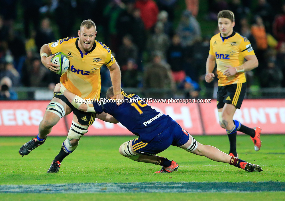 Hurricane's James Broadhurst beats a tackle. Super 15 rugby match. Hurricanes v Highlanders, McLean Park, Napier, New Zealand. Friday, 06 June, 2015. Photo: John Cowpland / www.photosport.co.nz