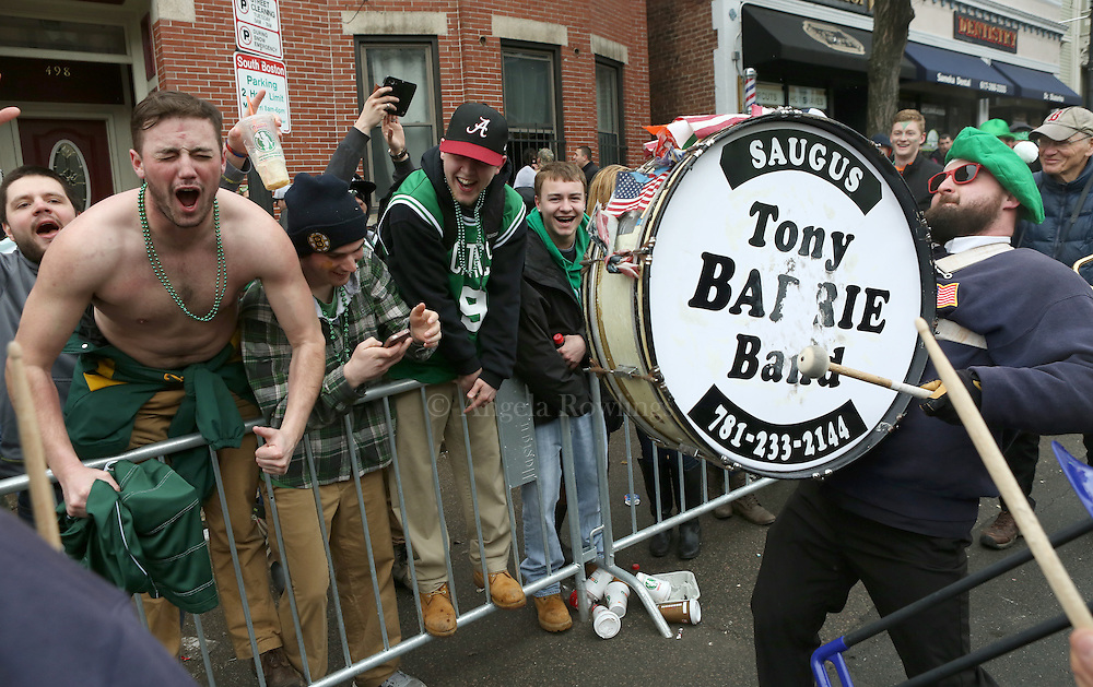 (Boston, MA - 3/15/15) Revelers cheer as the Tony Barry Band plays during the St. Patrick's Day Parade in South Boston, Sunday, March 15, 2015. Staff photo by Angela Rowlings.