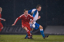 BRISTOL, ENGLAND - Thursday, January 15, 2009: Liverpool's Adam Pepper in action against Bristol Rovers' Ollie Clarke during the FA Youth Cup match at the Memorial Stadium. (Mandatory credit: David Rawcliffe/Propaganda)