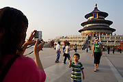 Tiantan (Temple of Heaven). Tourists taking souvenir photos with digicams.