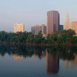 The skyline of Hartford, Connecticut reflects in the Connecticut River.