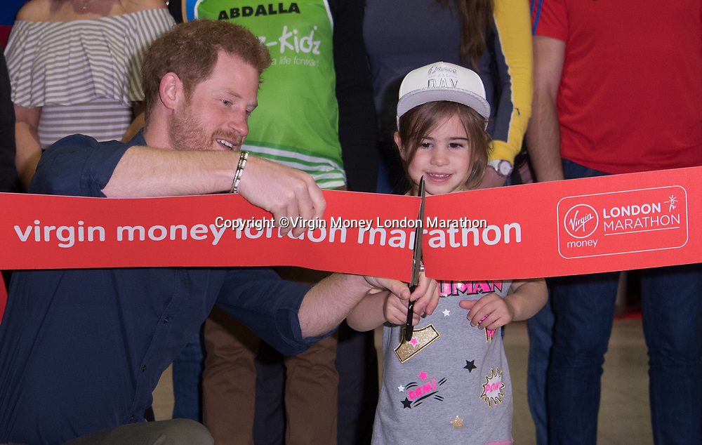 Prince Henry of Wales (Prince Harry) with Melissa Howes (5) daughter of Tony Howes who is running the Marathon opens the Virgin Money London Marathon Expo at the ExCel Centre in Docklands. The Virgin Money London Marathon, 19th April 2017.<br /> <br /> Photo: Bob Martin for Virgin Money London Marathon<br /> <br /> For further information: media@londonmarathonevents.co.uk