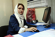 Zahra Mohseni, 23, the director of 'Family Live Show', a television program broadcasted live by Channel 1, an Afghan national television, is sitting at her desk in Kabul, Afghanistan.