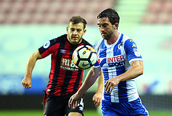 Will Grigg of Wigan Athletic goes past Ryan Fraser of Bournemouth - Mandatory by-line: Robbie Stephenson/JMP - 17/01/2018 - FOOTBALL - DW Stadium - Wigan, England - Wigan Athletic v Bournemouth - Emirates FA Cup third round proper
