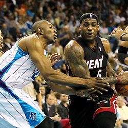November 5, 2010; New Orleans, LA, USA; Miami Heat small forward LeBron James (6) drives past New Orleans Hornets center D.J. Mbenga (28) of the Congo during the second quarter at the New Orleans Arena. Mandatory Credit: Derick E. Hingle